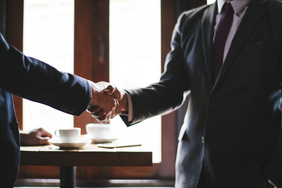 Download Free Stock HD Photo of Two business people shaking hands Online