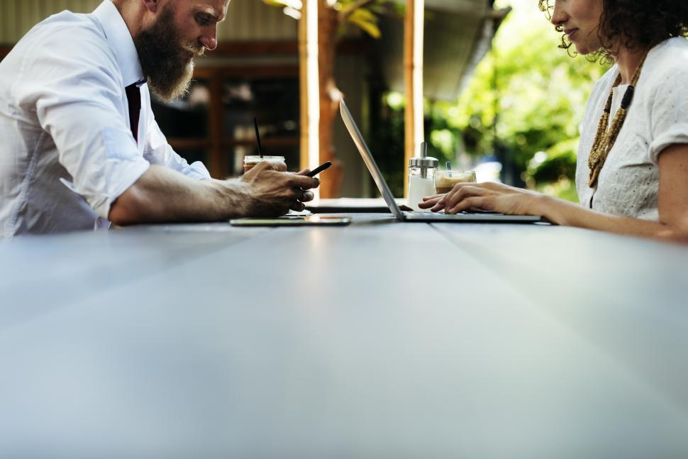 Download Free Stock HD Photo of Close up of two business people working with table foreground Online