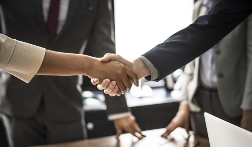 Download Free Stock HD Photo of Business people shaking hands in agreement Online