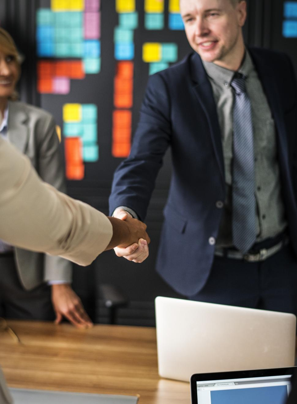 Download Free Stock HD Photo of Shaking hands after a meeting Online