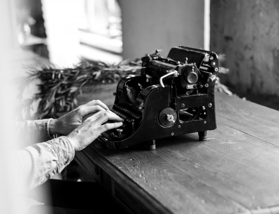 Download Free Stock HD Photo of Black and white of typing on a vintage typewriter Online