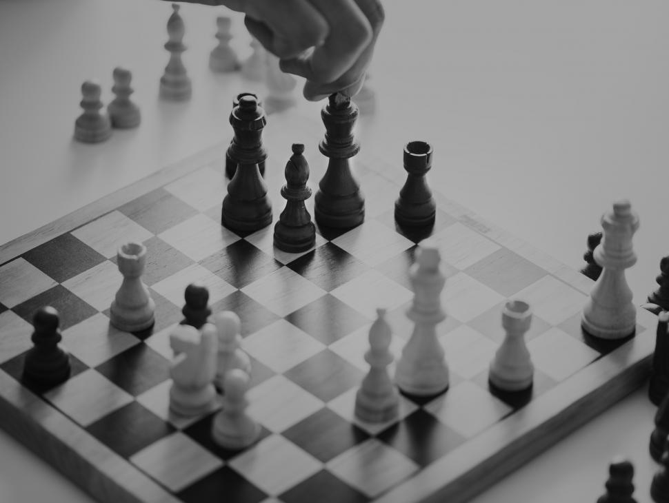 Download Free Stock HD Photo of Close up of a person s hand playing chess, monochrome Online