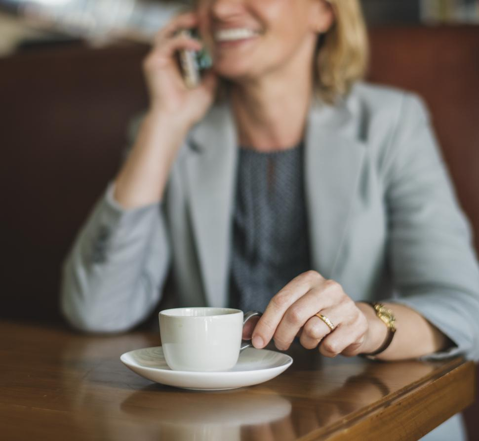 Download Free Stock HD Photo of A Caucasian businesswoman calling on her mobile phone Online