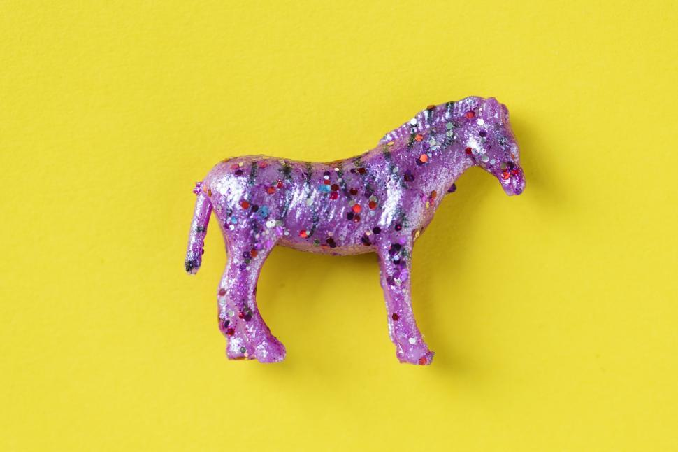 Download Free Stock HD Photo of Flat lay of a glittery toy horse Online