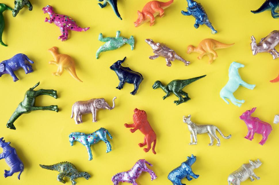 Download Free Stock HD Photo of Colorful toy animals on yellow surface Online