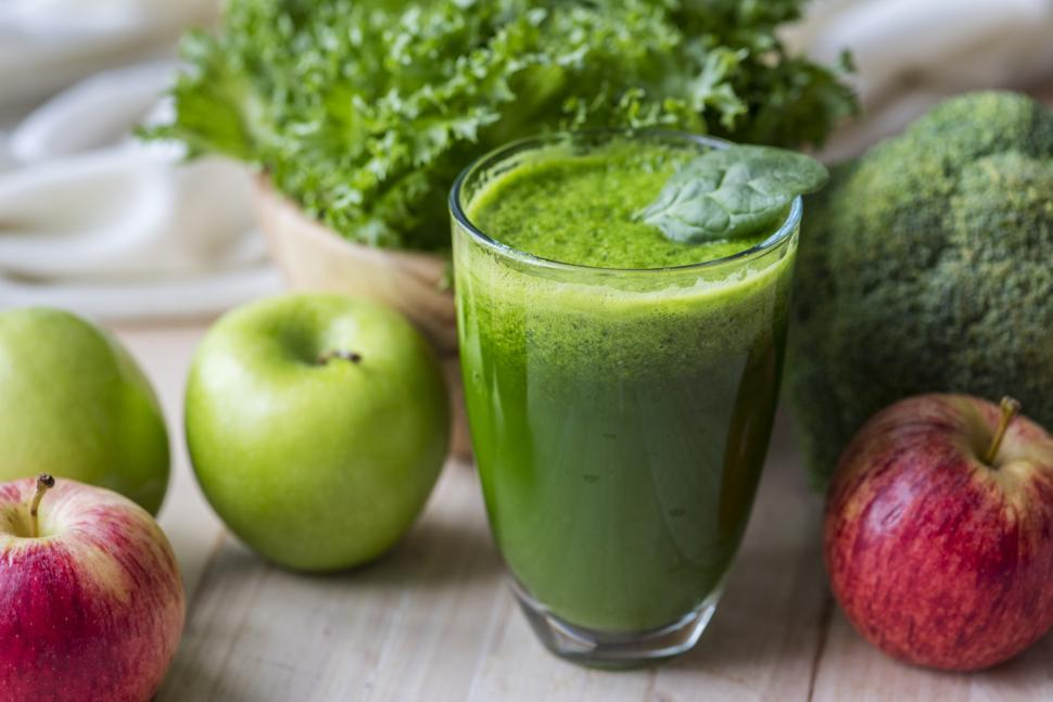 Download Free Stock HD Photo of Close up of a glass of apple and vegetable smoothie Online