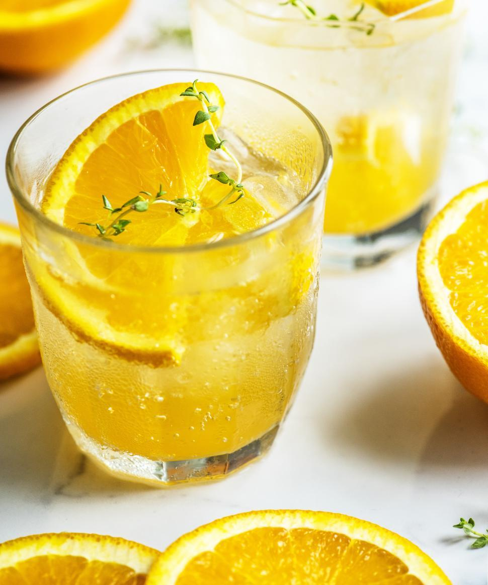 Download Free Stock HD Photo of Close up of chilled beverage in glasses garnished with orange slices Online