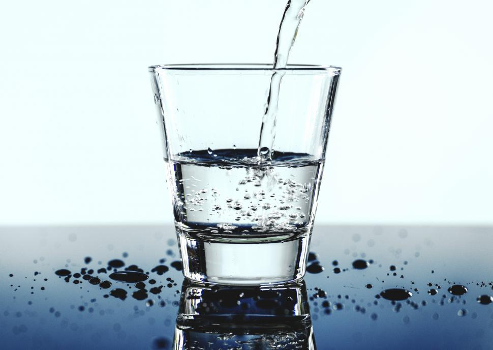 Download Free Stock HD Photo of White background - clear water being poured into a glass Online