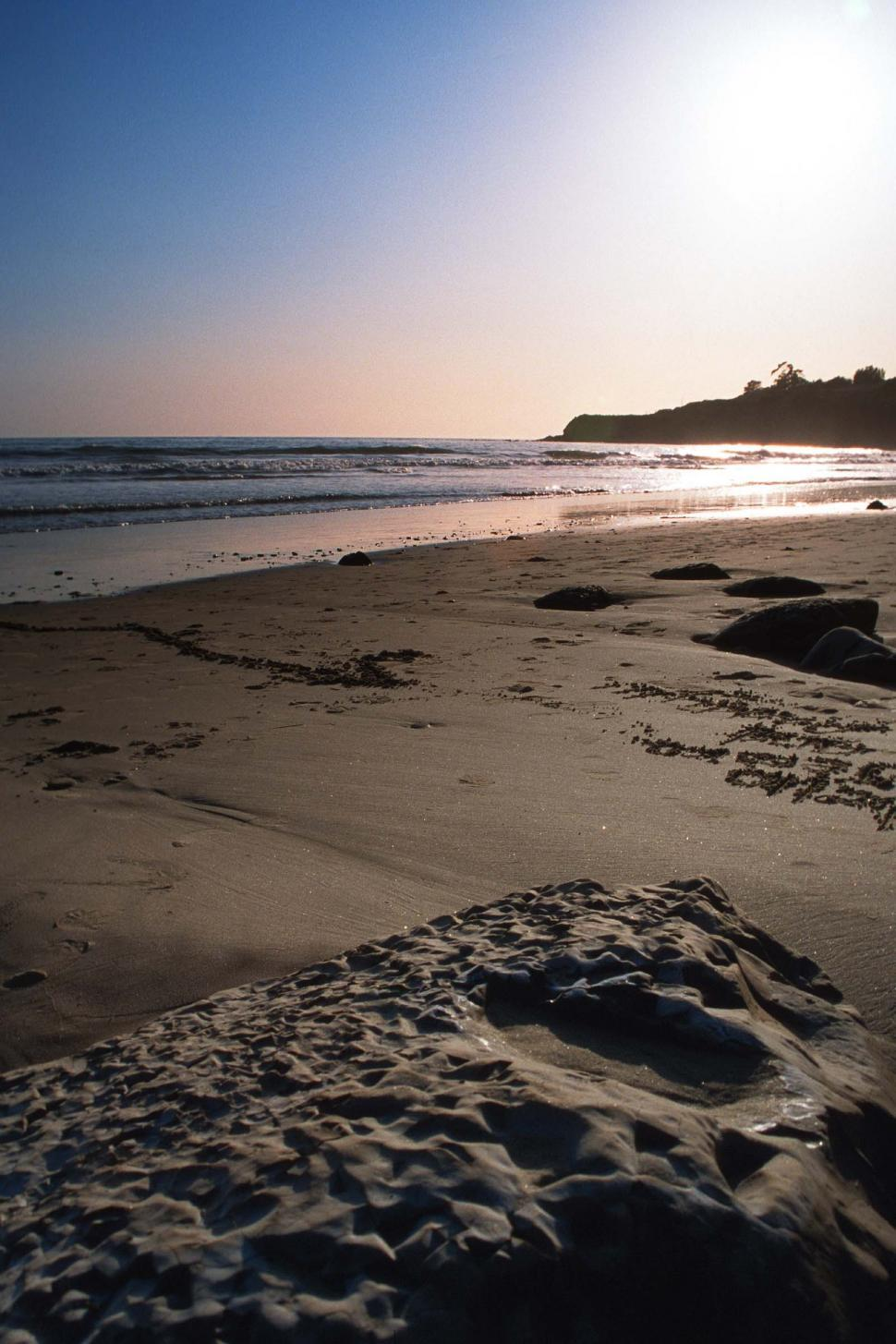 Download Free Stock HD Photo of Beach sunset with rocks and sand Online