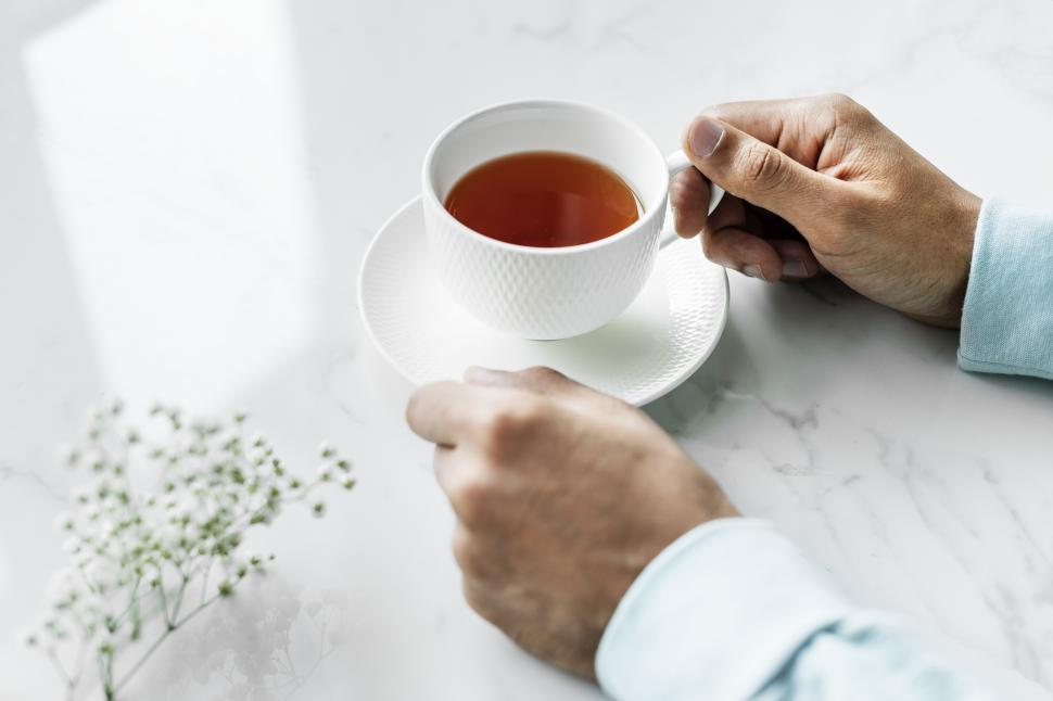 Download Free Stock HD Photo of Close up of a hands and a cup of tea Online