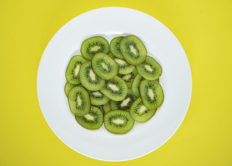 Download Free Stock HD Photo of Flat lay of kiwi slices on white plate Online