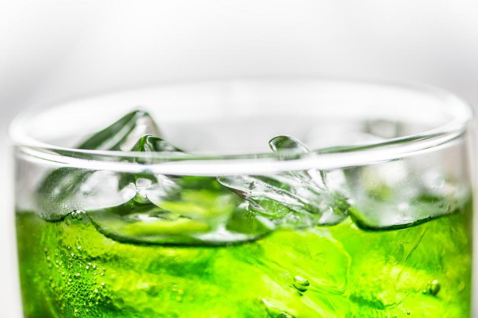 Download Free Stock HD Photo of Green energy drink served in a pint glass Online