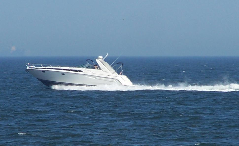 Download Free Stock HD Photo of Boat Speeding Across Atlantic Online