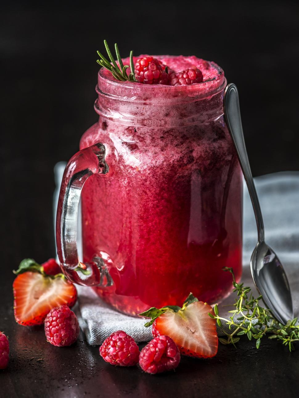 Download Free Stock HD Photo of Strawberry and raspberry smoothie in a jar Online
