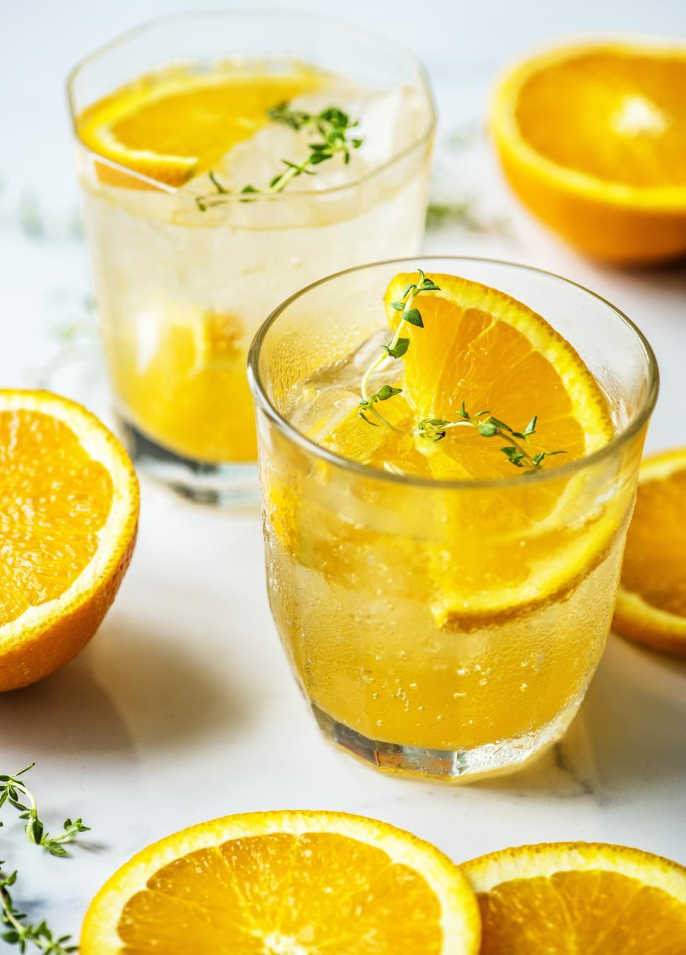 Download Free Stock HD Photo of Chilled beverages in glasses garnished with orange slices Online