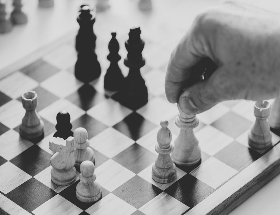 Download Free Stock HD Photo of Close up of a person playing chess Online