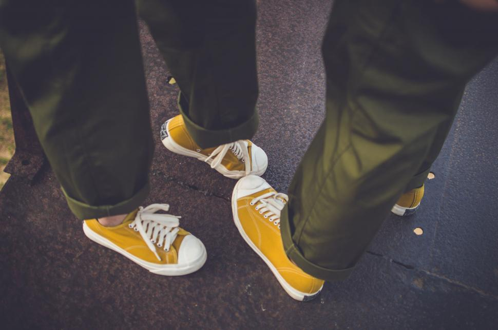 People Feet with yellow canvas shoes