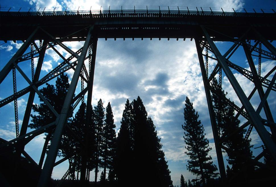 Free image of Tall structure of a train trestle spans a gorge