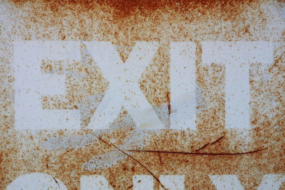 Free image of Painted exit sign has seen better days