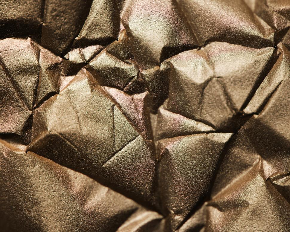 Download Free Stock HD Photo of Abstract textured background of wrinkled golden paper Online