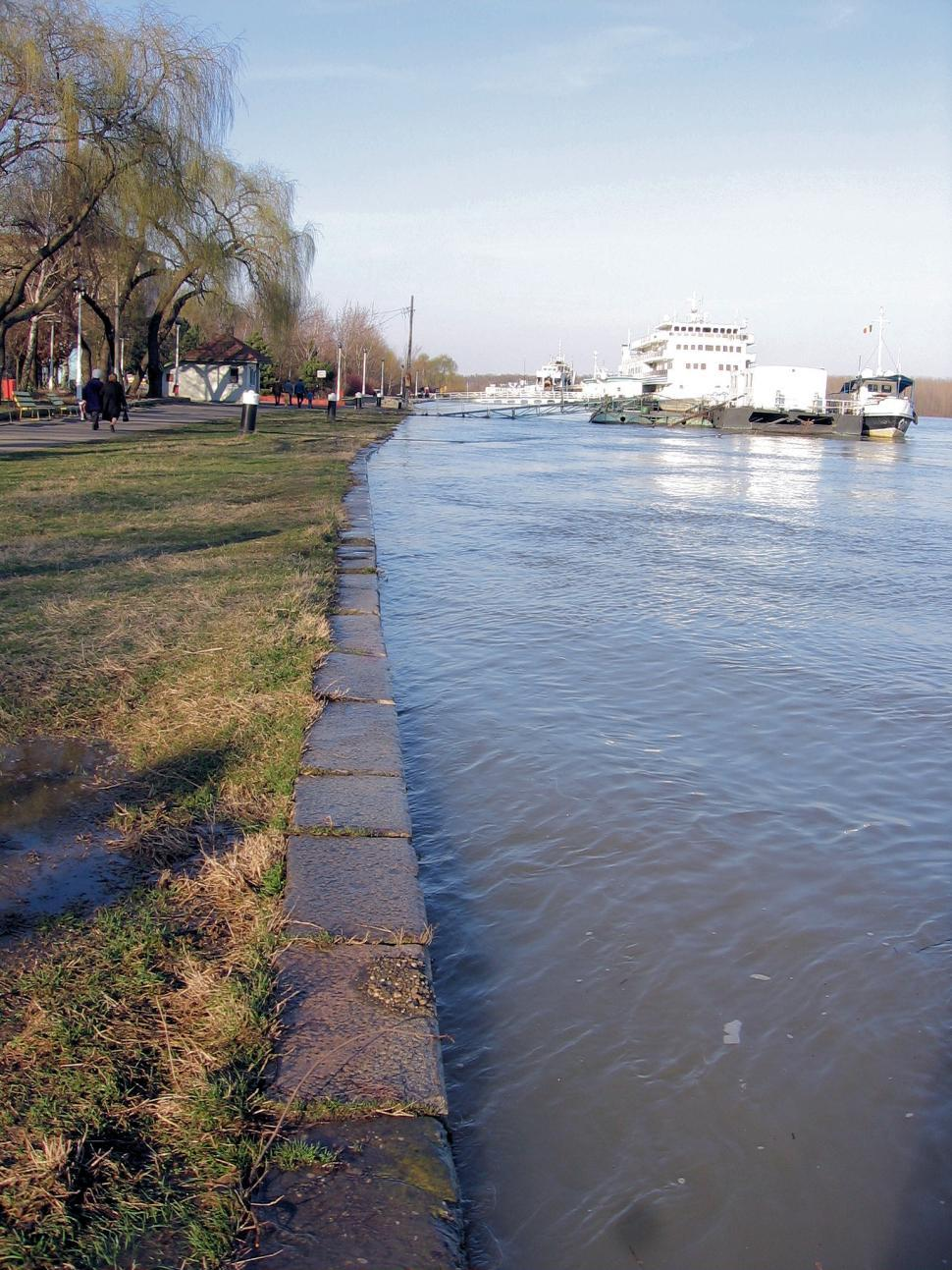 Download Free Stock HD Photo of flood water on local park walkway after heavy rain fall Online