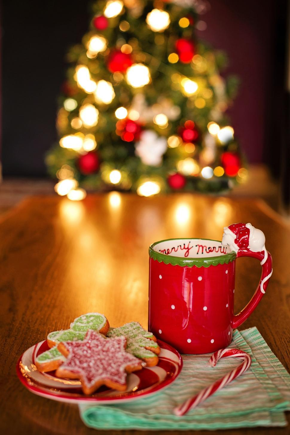 Free Stock Photo Of Red Coffee Mug With Cookies And Christmas Tree Online Download Latest Free Images And Free Illustrations