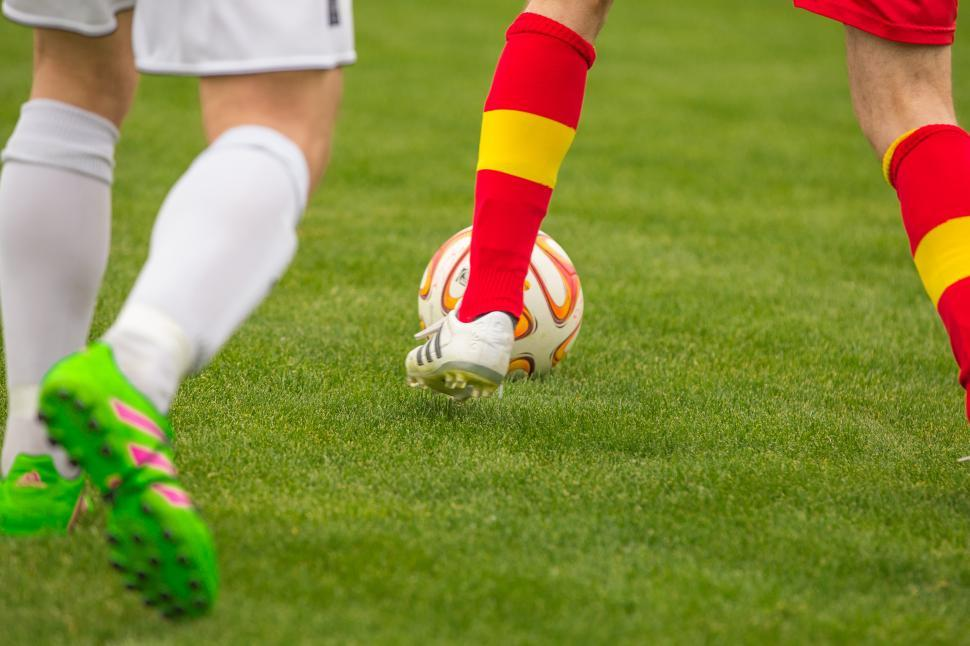Download Free Stock HD Photo of Footballers leg, shoes and ball Online