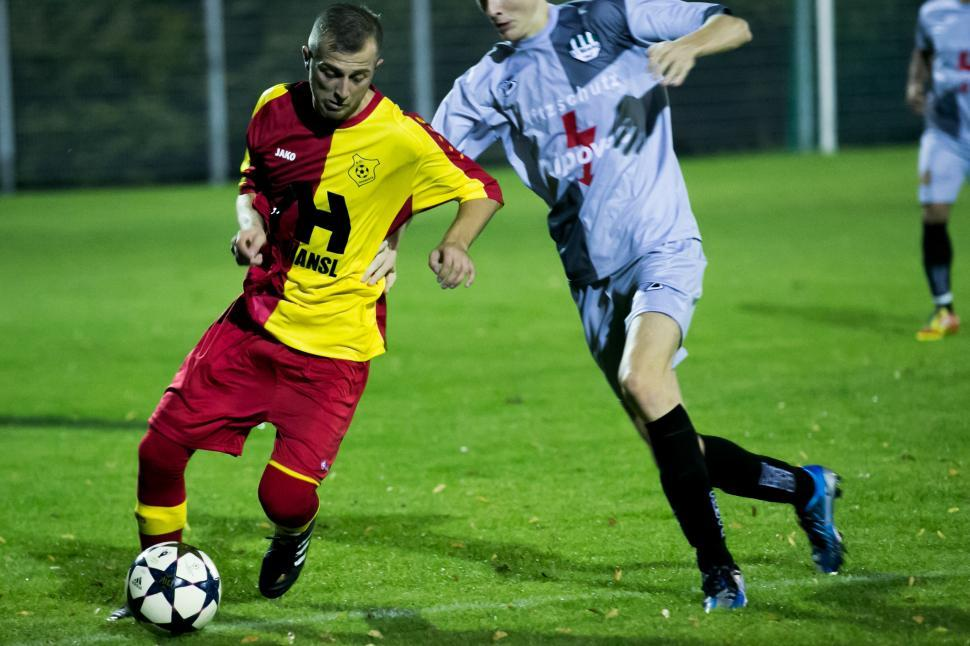 Download Free Stock HD Photo of Soccer players fighting for ball during a match Online