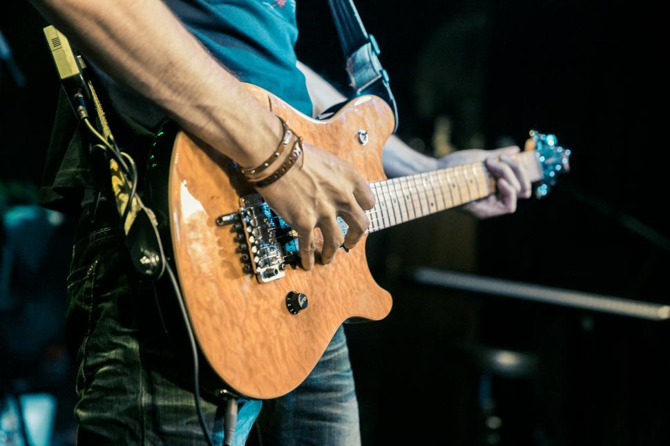 Download Free Stock HD Photo of Guitarist playing guitar on stage Online