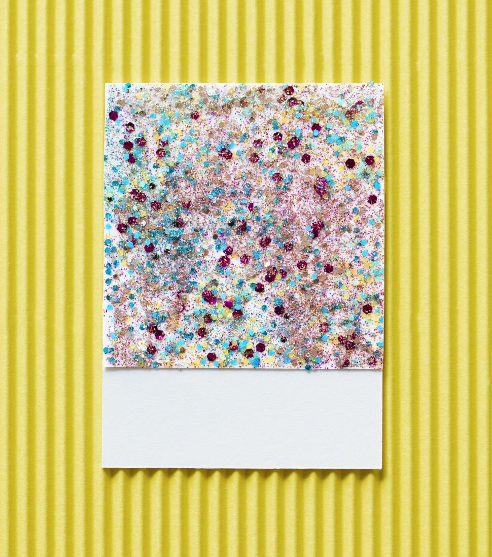 Download Free Stock HD Photo of Flat lay of glitter sparkles on spaced cardboard frame Online