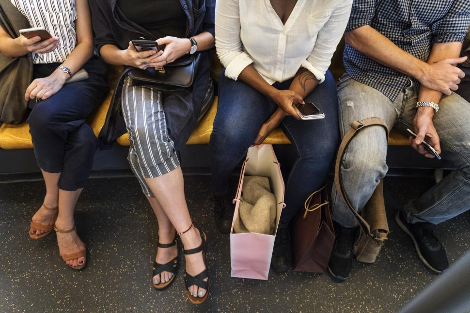 Download Free Stock HD Photo of A close up of multiethnic commuters seated on a train Online