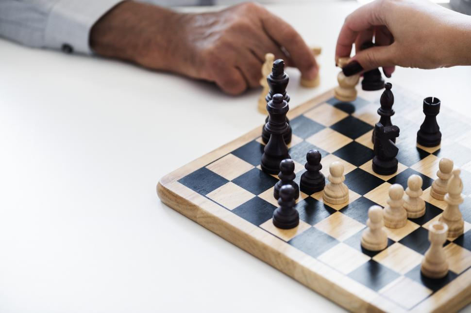 Download Free Stock HD Photo of Close up of people playing chess, small chess board Online