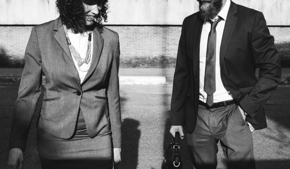 Download Free Stock HD Photo of Two business people taking a walk and talking Online