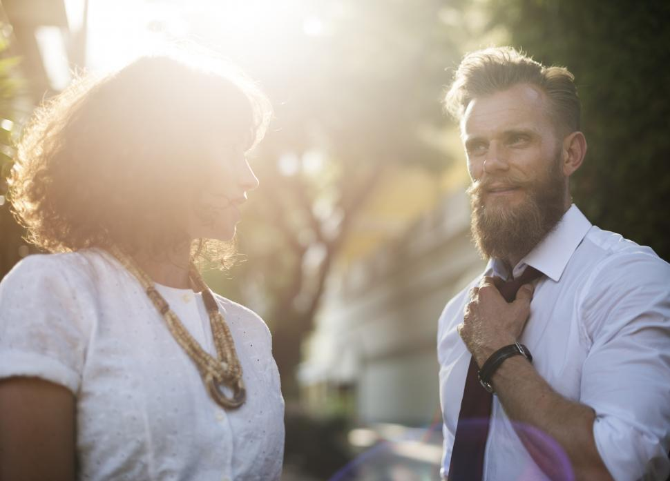Download Free Stock HD Photo of Two business people in a discussion in the sun Online