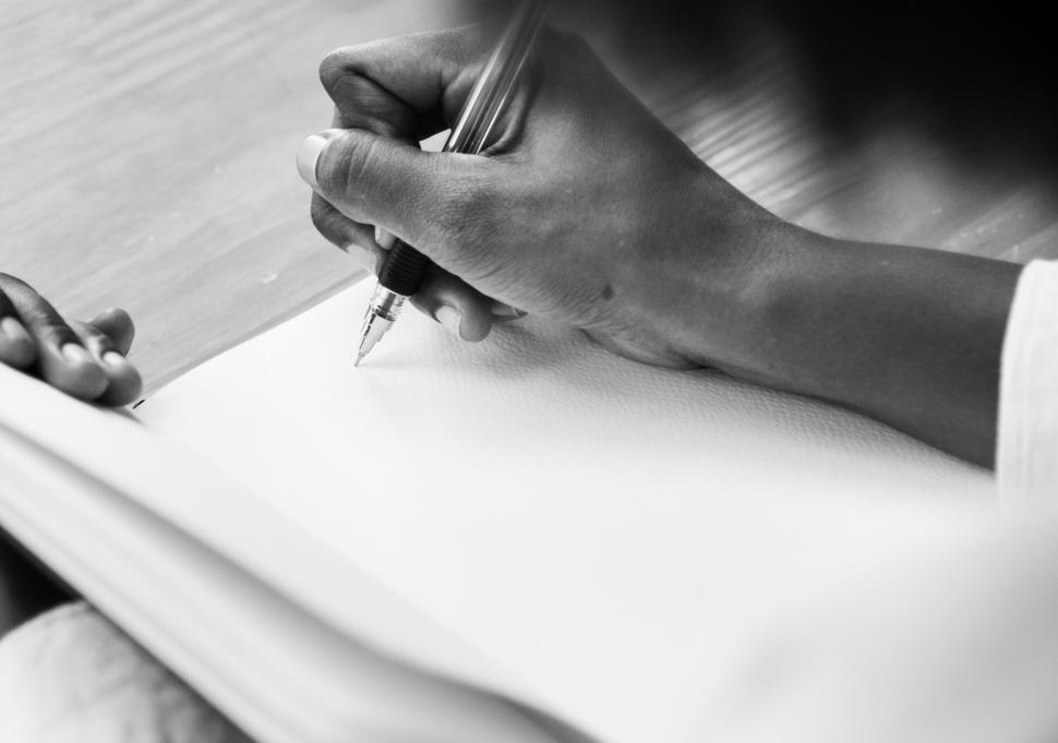 Download Free Stock HD Photo of Close up of hand writing on a notebook Online