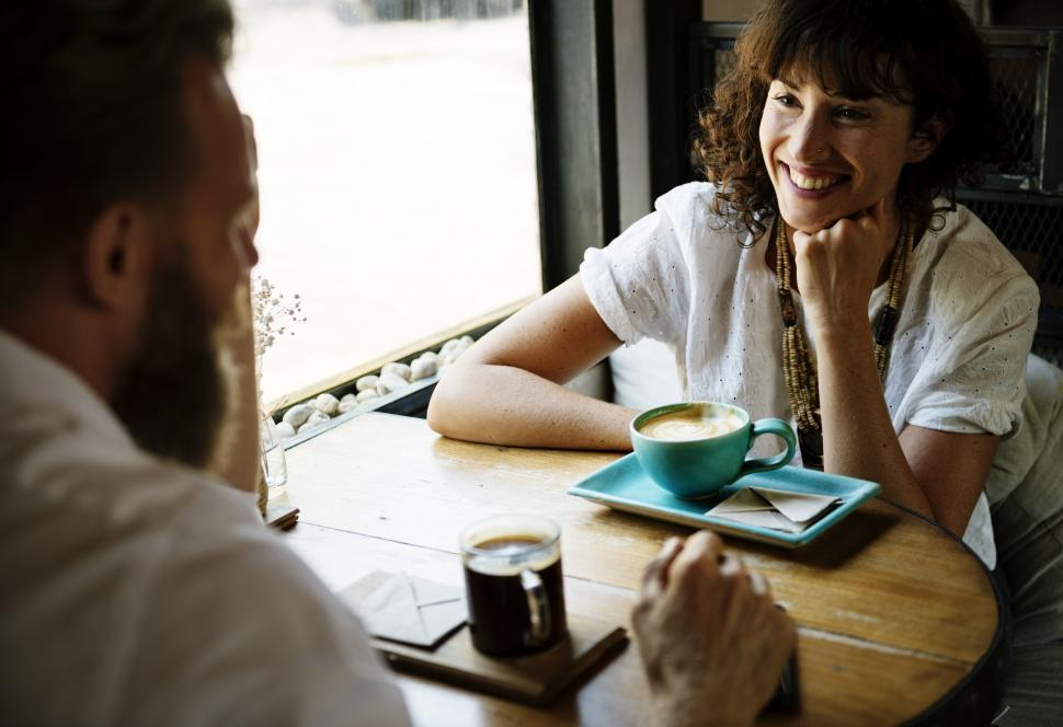 Download Free Stock HD Photo of Friendly people discussing at a restaurant table Online