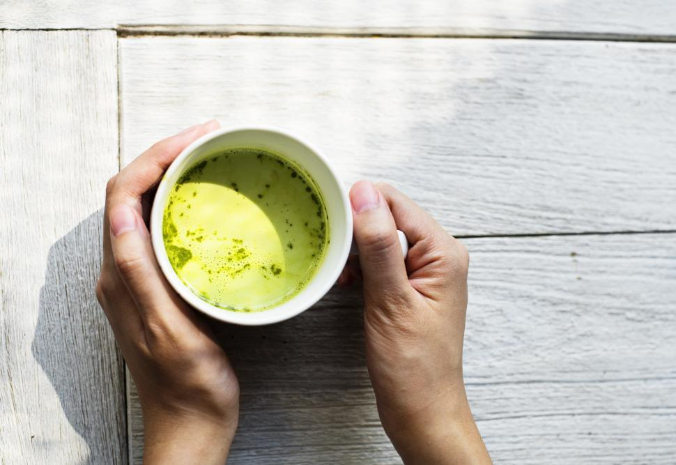 Download Free Stock HD Photo of Overhead view of a cup of Matcha green Tea Online