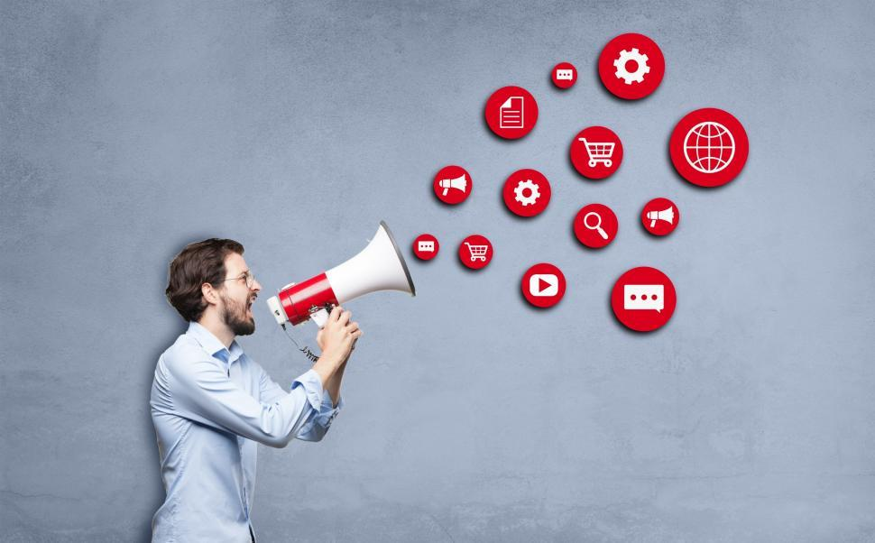 Marketing Concept - Man Shouting with Megaphone
