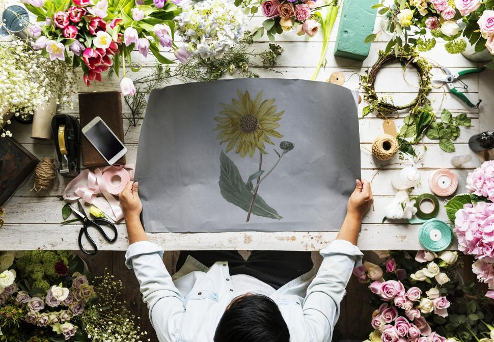 Download Free Stock HD Photo of Paper with flower illustration on a florist s table Online