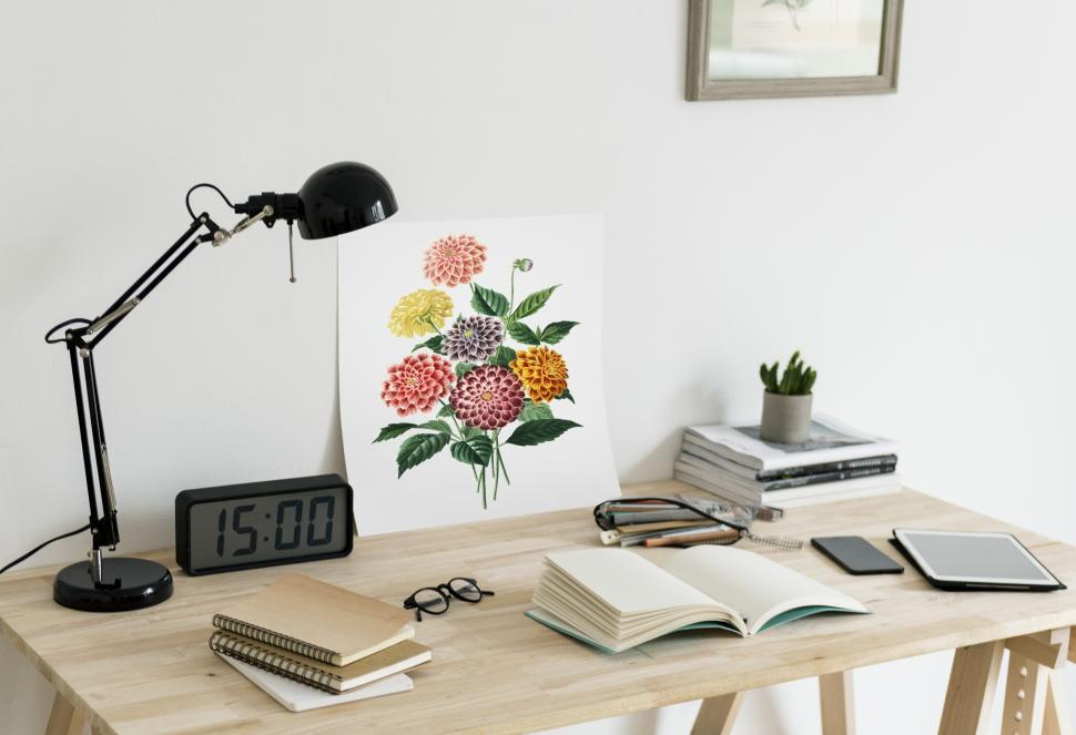 Download Free Stock HD Photo of Close up of a illustration and books on a study table Online