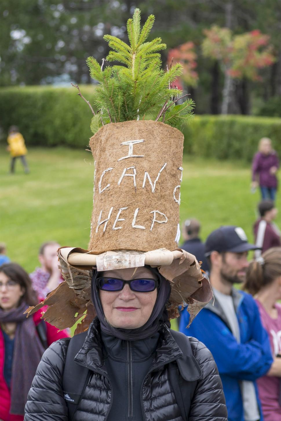 Download Free Stock HD Photo of Lady in a hat at a climate protest Online