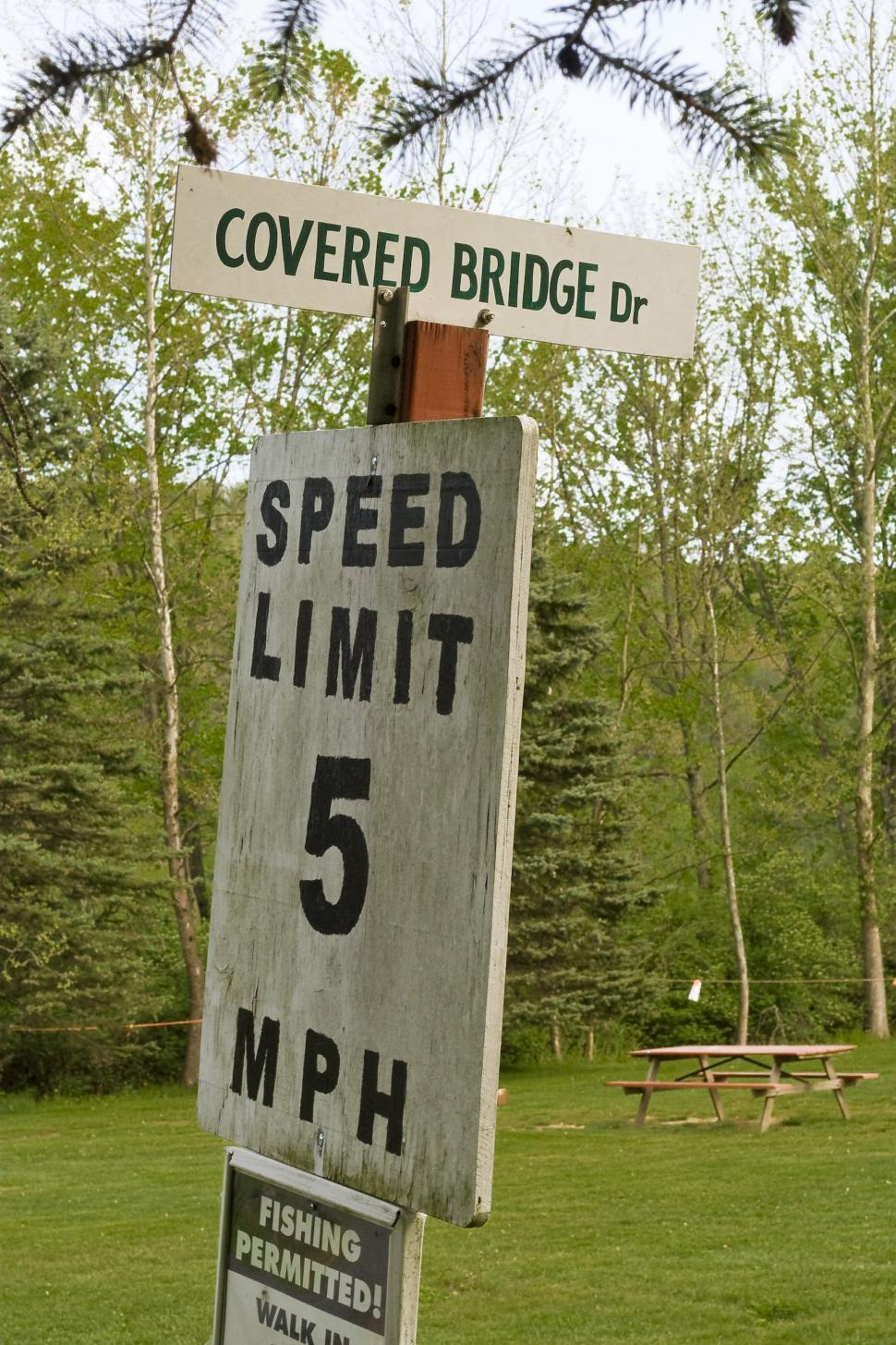 Download Free Stock HD Photo of Covered Bridge Dr. and Speed limit sign Online
