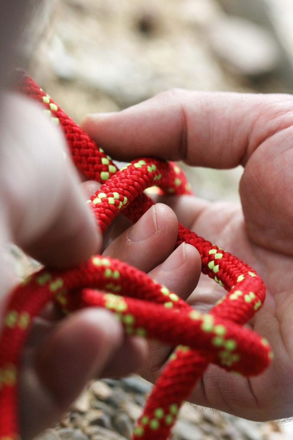 Download Free Stock HD Photo of Hands working on a rope and knot Online