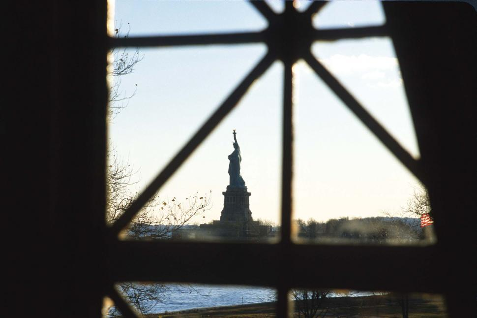 Download Free Stock HD Photo of Ellis Island Immigration Station with Liberty Island  Online