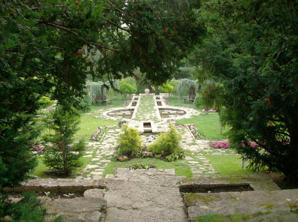 Download Free Stock HD Photo of Small garden with water ponds and lush vegetation Online