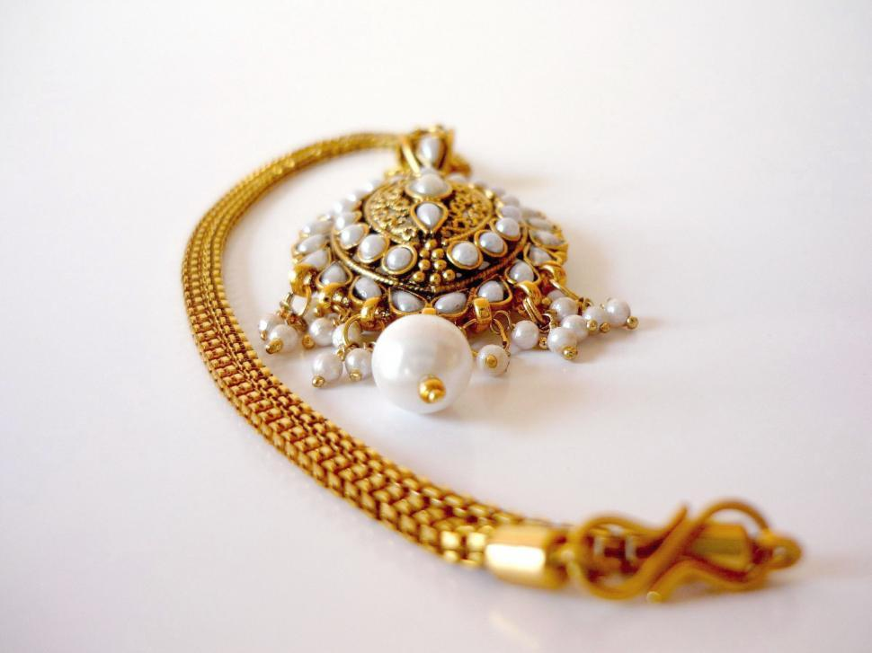 Download Free Stock HD Photo of Gold and pearl necklace Online