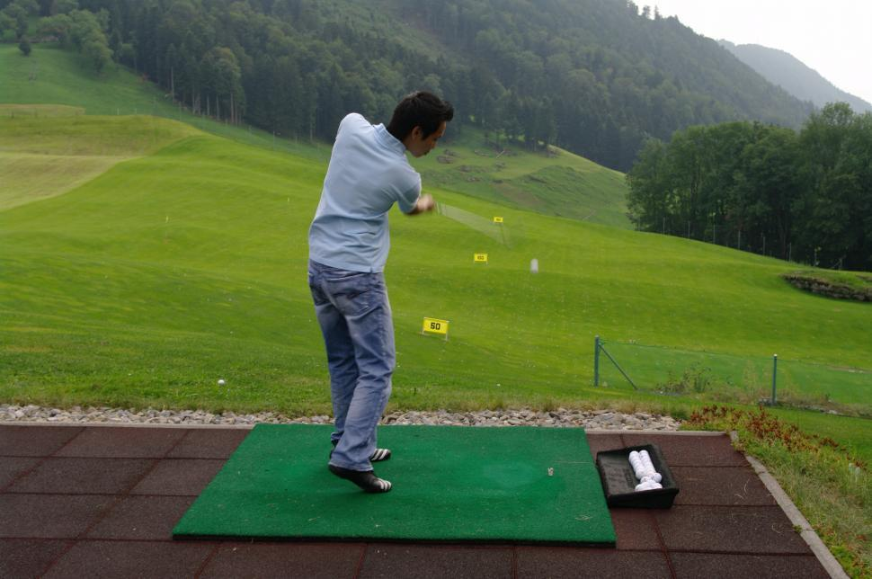 Download Free Stock HD Photo of golfer practicing Online