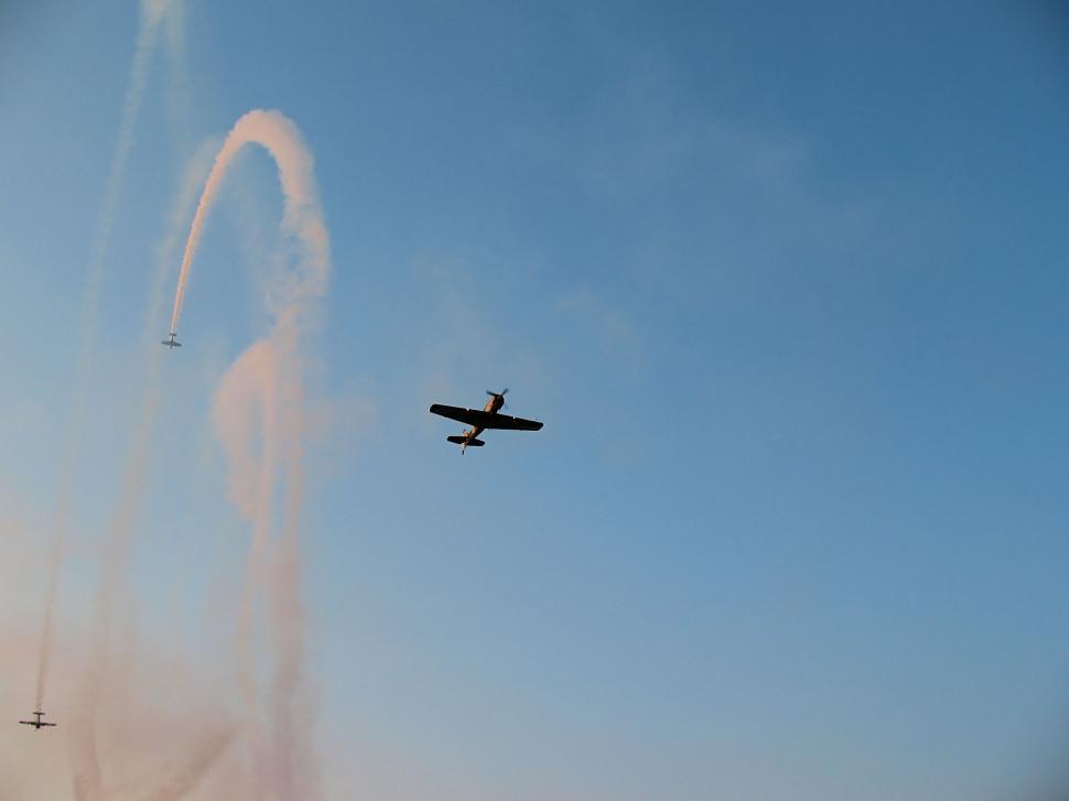 Download Free Stock HD Photo of Aerobatic team making loopings in the air Online
