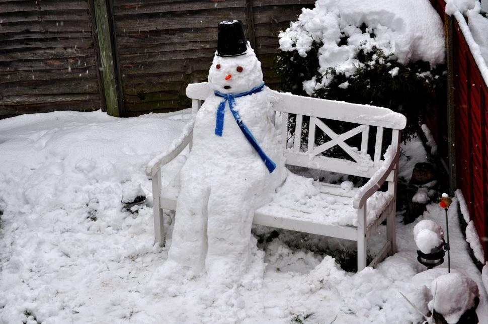 Download Free Stock HD Photo of Snowman on the garden chair Online