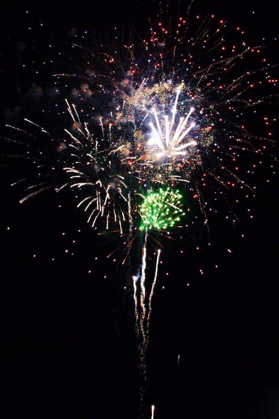 Download Free Stock HD Photo of Fireworks explode in night sky Online